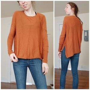 High low orange long sleeve shirt